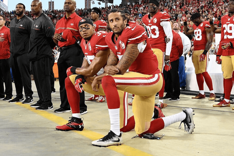 SANTA CLARA, CA - SEPTEMBER 12: Colin Kaepernick #7 and Eric Reid #35 of the San Francisco 49ers kneel in protest during the national anthem prior to playing the Los Angeles Rams in their NFL game at Levi's Stadium on September 12, 2016 in Santa Clara, California.