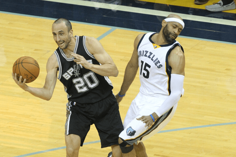 Apr 27, 2017; Memphis, TN, USA; San Antonio Spurs guard Manu Ginobili (20) is fouled by Memphis Grizzlies guard Vince Carter (15) in game six of the first round of the 2017 NBA Playoffs at FedExForum