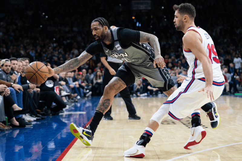 Feb 20, 2020; Philadelphia, Pennsylvania, USA; Brooklyn Nets forward Wilson Chandler (21) lunges to keep the ball in bounds in front of Philadelphia 76ers guard Raul Neto (19) during the fourth quarter at Wells Fargo Center