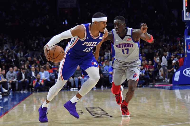 Mar 11, 2020; Philadelphia, Pennsylvania, USA; Philadelphia 76ers forward Tobias Harris (12) drives to the basket against Detroit Pistons forward Tony Snell (17) during the third quarter at Wells Fargo Center.