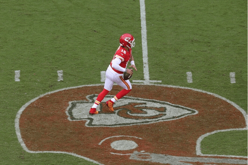 KANSAS CITY, MO - SEPTEMBER 22: A view from above as Kansas City Chiefs quarterback Patrick Mahomes (15) looks to pass from the midfield logo in the third quarter of an AFC matchup between the Baltimore Ravens and Kansas City Chiefs on September 22, 2019 at Arrowhead Stadium in Kansas City, MO.