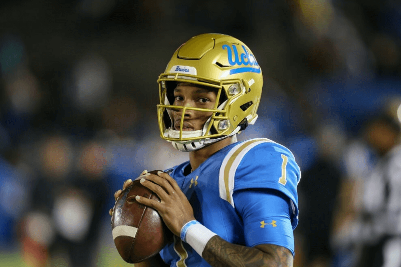 PASADENA, CA - NOVEMBER 30: UCLA Bruins quarterback Dorian Thompson-Robinson (1) warms up during a timeout during the college football game between the California Golden Bears and the UCLA Bruins on November 30, 2019, at the Rose Bowl in Pasadena, CA.