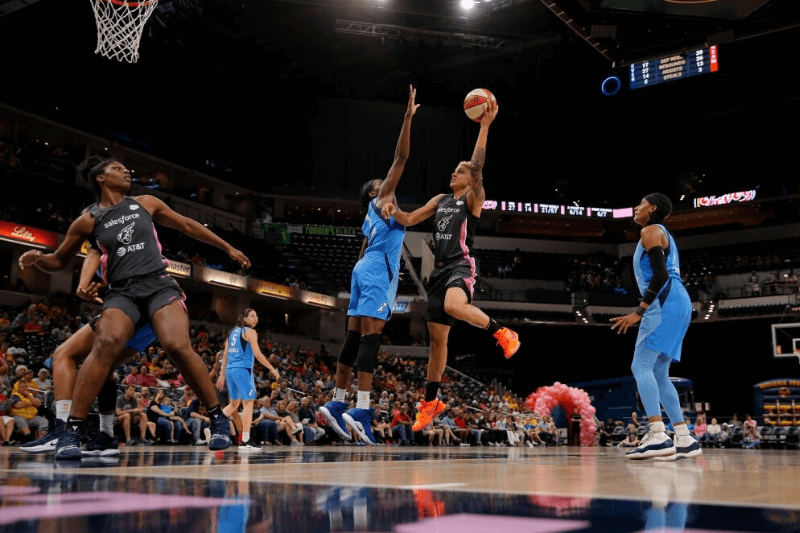 INDIANAPOLIS, IN AUGUST 10 2019: Indiana Fever forward Candice Dupree (4) goes up with the shot while being defended by Atlanta Dream center Elizabeth Williams (1) during the game between the Atlanta Dream and Indiana Fever Aug. 10, 2019, at Bankers Life Fieldhouse in Indianapolis, IN.