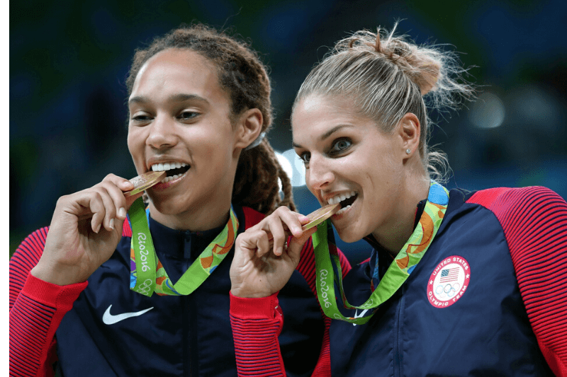 Aug 20, 2016; Rio de Janeiro, Brazil; USA center Brittney Griner (15) and USA forward/guard Elena Delle Donne (11) celebrates with their medal after beating Spain in the women's basketball gold medal match during the Rio 2016 Summer Olympic Games at Carioca Arena 1.