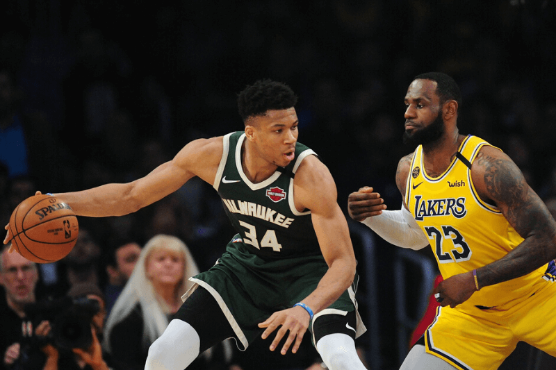 March 6, 2020; Los Angeles, California, USA; Milwaukee Bucks forward Giannis Antetokounmpo (34) controls the ball against Los Angeles Lakers forward LeBron James (23) during the first half at Staples Center