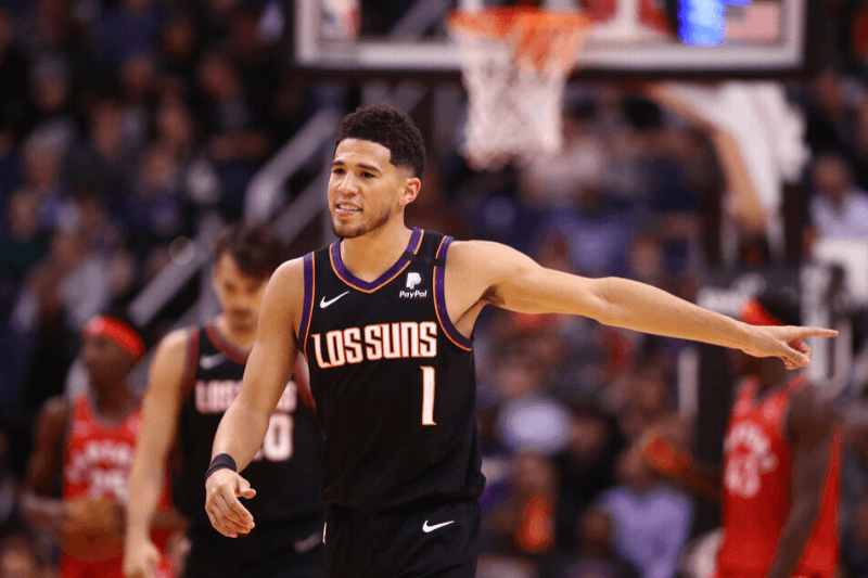 Mar 3, 2020; Phoenix, Arizona, USA; Phoenix Suns guard Devin Booker (1) reacts against the Toronto Raptors at Talking Stick Resort Arena.