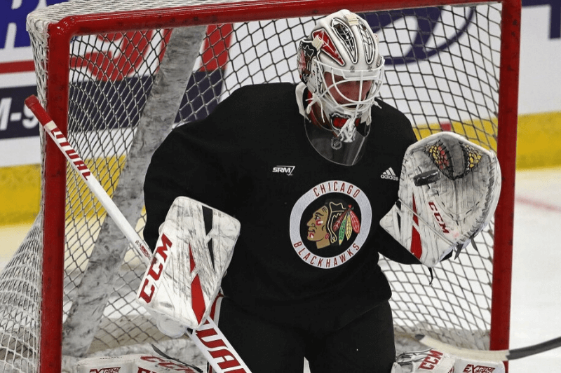 CHICAGO, ILLINOIS - JULY 14: Kevin Lankinen #34 of the Chicago Blackhawks makes a glove save during a summer training camp practice at Fifth Third Arena on July 14, 2020 in Chicago, Illinois.