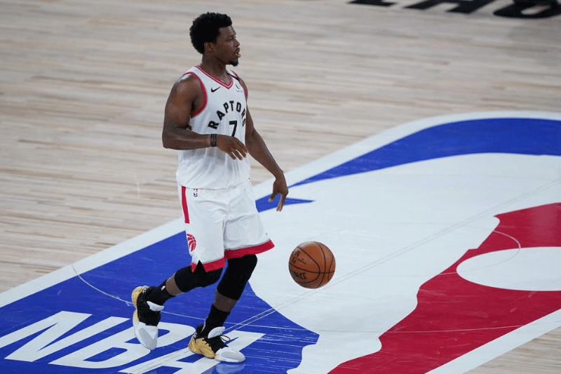 Aug 1, 2020; Lake Buena Vista, USA; Toronto Raptors guard Kyle Lowry (7) brings the ball up court during the second half against the Los Angeles Lakers at The Arena.