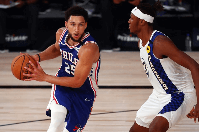 Aug 1, 2020; Lake Buena Vista, Florida, USA; Philadelphia 76ers guard Ben Simmons (25) drives to the basket against Indiana Pacers center Myles Turner (33) during the third quarter of a NBA basketball game at Visa Athletic Center.