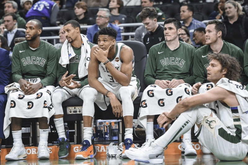 Dec 14, 2019; Milwaukee, WI, USA; Milwaukee Bucks forward Khris Middleton (22), guard George Hill (3), forward Giannis Antetokounmpo (34), forward Ersan Ilyasova (7) and center Robin Lopez (42) rest during game against the Cleveland Cavaliers in the fourth quarter at Fiserv Forum