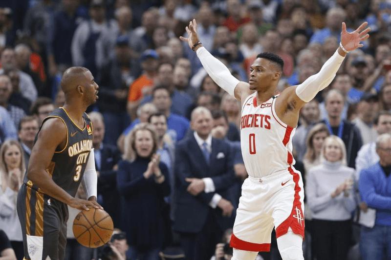 Jan 9, 2020; Oklahoma City, Oklahoma, USA; Houston Rockets guard Russell Westbrook (0) pressures Oklahoma City Thunder guard Chris Paul (3) during the first quarter at Chesapeake Energy Arena.