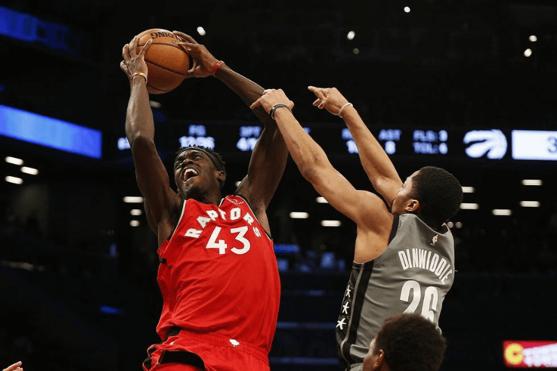 Feb 12, 2020; Brooklyn, New York, USA; Toronto Raptors forward Pascal Siakam (43) drives against Brooklyn Nets guard Spencer Dinwiddie (26) during the first half at Barclays Center.