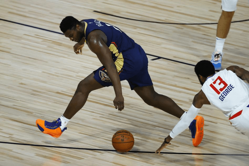 Aug 1, 2020; Lake Buena Vista, USA; Zion Williamson #1 of the New Orleans Pelicans looses the ball against Paul George #13 of the LA Clippers at HP Field House at ESPN Wide World Of Sports Complex on August 01, 2020 in Lake Buena Vista, Florida.