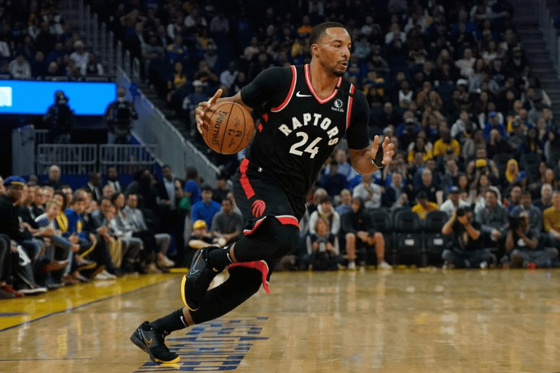 Mar 5, 2020; San Francisco, California, USA; Toronto Raptors guard Norman Powell (24) controls the ball against the Golden State Warriors during the first quarter at Chase Center.