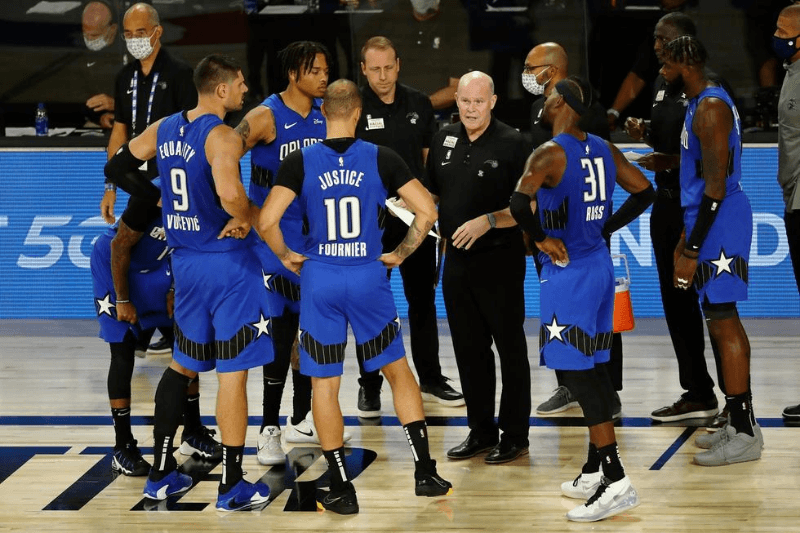 Aug 18, 2020; Lake Buena Vista, Florida, USA; Orlando Magic head coach Steve Clifford with the team during a time out during the second half of Game 1 of an NBA basketball first-round playoff series against the Milwaukee Bucks at The Field House