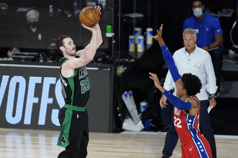Aug 17, 2020; Lake Buena Vista, Florida, USA; Boston Celtics forward Gordon Hayward (20) shoots against Philadelphia 76ers guard Matisse Thybulle (22) in game one of the first round of the 2020 NBA Playoffs at The Field House