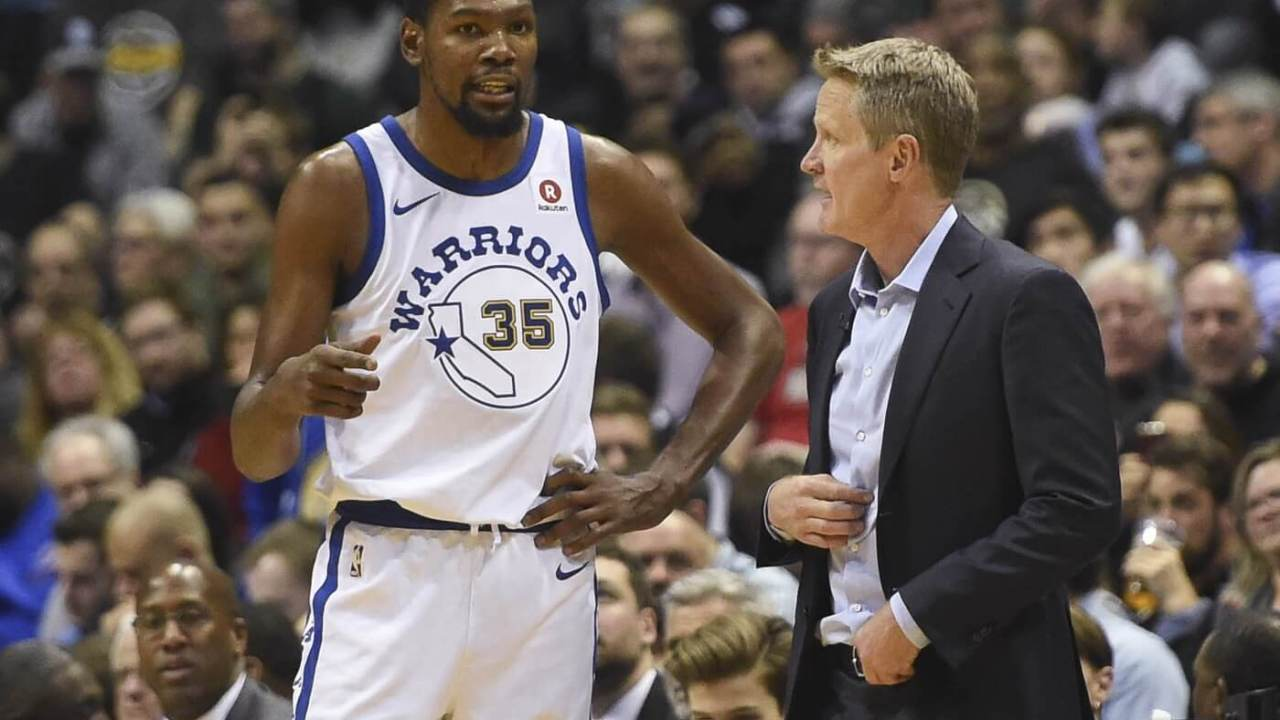 Jan 12, 2018; Milwaukee, WI, USA; Golden State Warriors head coach Steve Kerr talks to forward Kevin Durant (35) in the fourth quarter during the game against the Milwaukee Bucks at BMO Harris Bradley Center. Mandatory Credit: Benny Sieu-USA TODAY Sports