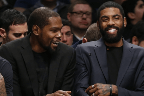 Jan 7, 2020; Brooklyn, New York, USA; Brooklyn Nets forward Kevin Durant (7) and guard Kyrie Irving (11) react in the third quarter against the Oklahoma City Thunder at Barclays Center. Mandatory Credit: Nicole Sweet-USA TODAY Sports