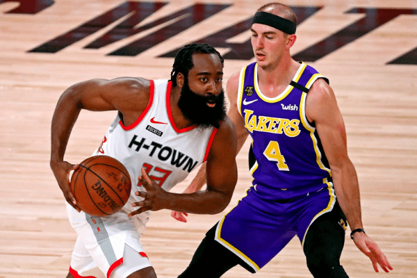 Sep 4, 2020; Lake Buena Vista, Florida, USA; Houston Rockets guard James Harden (13) drives to the basket against Los Angeles Lakers guard Alex Caruso (4) during the second quarter in game one of the second round of the 2020 NBA Playoffs at AdventHealth Arena. Mandatory Credit: Kim Klement-USA TODAY Sports