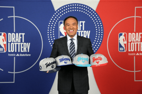 SECAUCUS, NJ - AUGUST 20: Deputy Commissioner of the NBA, Mark Tatum holds up the team hats of the Golden State Warriors, Minnesota Timberwolves, Charlotte Hornets and Charlotte Hornets during the 2020 NBA Draft Lottery on August 20, 2020 at the NBA Entertainment Studios in Secaucus, New Jersey. NOTE TO USER: User expressly acknowledges and agrees that, by downloading and/or using this photograph, user is consenting to the terms and conditions of the Getty Images License Agreement. Mandatory Copyright Notice: Copyright 2020 NBAE