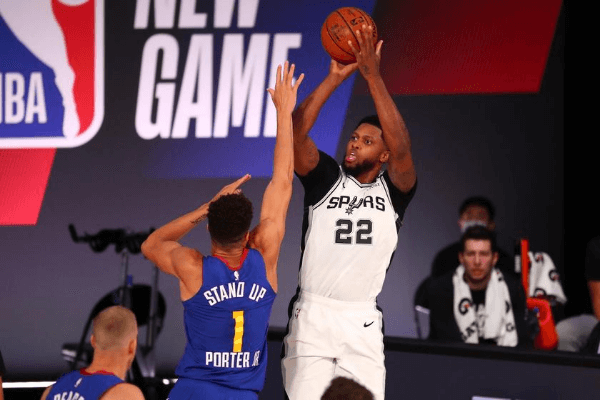 Aug 5, 2020; Lake Buena Vista, Florida, USA; San Antonio Spurs forward Rudy Gay (22) shoots against Denver Nuggets forward Michael Porter Jr. (1) during the first half of a NBA basketball game at Visa Athletic Center.