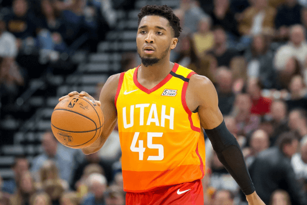 Jan 20, 2020; Salt Lake City, Utah, USA; Utah Jazz guard Donovan Mitchell (45) dribbles up the court during the second half against the Indiana Pacers at Vivint Smart Home Arena. Mandatory Credit: Russell Isabella-USA TODAY Sports