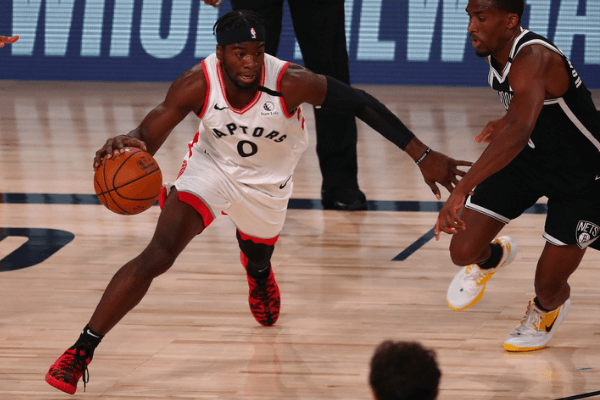 Aug 17, 2020; Orlando, Florida, USA; Toronto Raptors guard Terence Davis (0) drives against Brooklyn Nets guard Jeremiah Martin (0) during the second half in game one of the first round of the 2020 NBA Playoffs at AdventHealth Arena. Mandatory Credit: Kim Klement-USA TODAY Sports