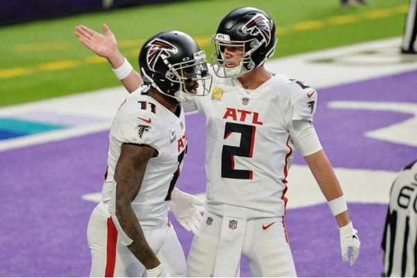 Oct 18, 2020; Minneapolis, Minnesota, USA; Atlanta Falcons quarterback Matt Ryan (2) and wide receiver Julio Jones (11) celebrate a touchdown during the first quarter against the Minnesota Vikings at U.S. Bank Stadium.