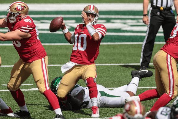 Sep 20, 2020; East Rutherford, New Jersey, USA; San Francisco 49ers quarterback Jimmy Garoppolo (10) is sacked by New York Jets defensive tackle Quinnen Williams (95) during the first quarter at MetLife Stadium.