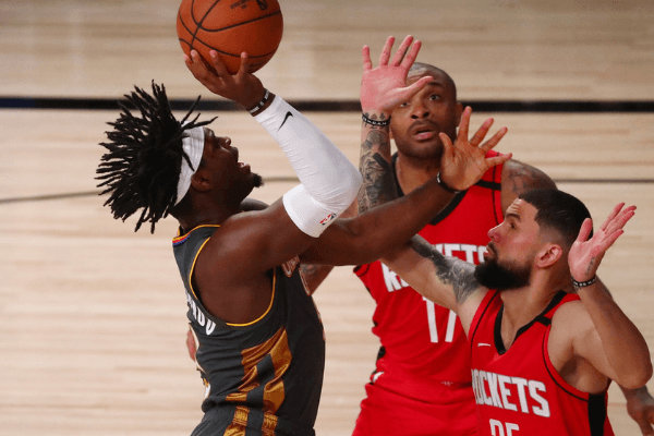 Aug 31, 2020; Lake Buena Vista, Florida, USA; Oklahoma City Thunder guard Luguentz Dort (5) shoots against Houston Rockets forward P.J. Tucker (17) and guard Austin Rivers (25) during the third quarter in game six of the first round of the 2020 NBA Playoffs at ESPN Wide World of Sports Complex.