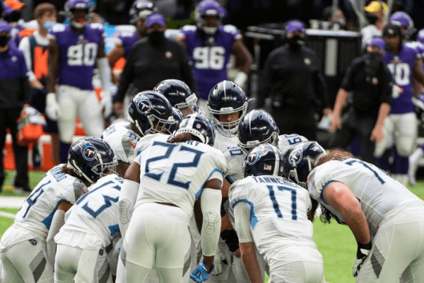 MINNEAPOLIS, MN - SEPTEMBER 27: Tennessee Titans players huddle in the second quarter of the game against the Minnesota Vikings at U.S. Bank Stadium on September 27, 2020 in Minneapolis, Minnesota.