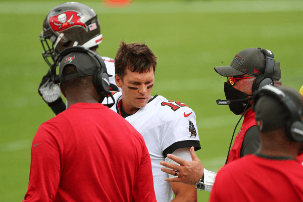 Sep 20, 2020; Tampa, Florida, USA; Tampa Bay Buccaneers quarterback Tom Brady (12) talks with head coach Bruce Arians (right) and offensive coordinator Byron Leftwich against the Carolina Panthers during the second quarter at Raymond James Stadium.