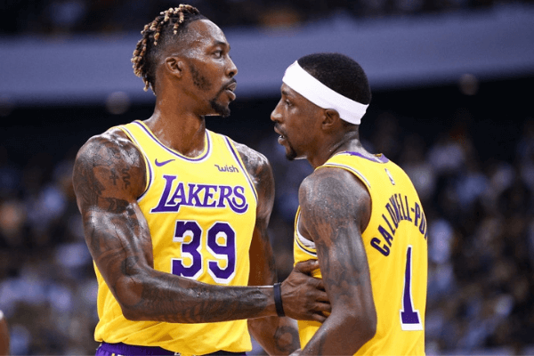 Dwight Howard #39 of the Los Angeles Lakers reacts with team mate Kentavious Caldwell-Pope #1 during the match against the Brooklyn Nets during a preseason game as part of 2019 NBA Global Games China at Shenzhen Universiade Center on October 12, 2019 in Shenzhen, Guangdong, China.