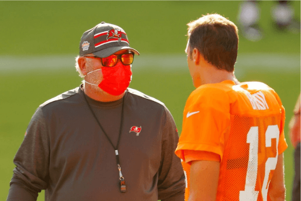 Head coach Bruce Arians of the Tampa Bay Buccaneers talks with Tom Brady #12 during training camp at Raymond James Stadium on August 28, 2020 in Tampa, Florida.