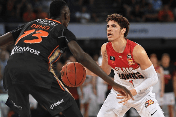 LaMelo Ball of the Hawks looks to get past Majok Deng of the Taipans during the round six NBL match between the Cairns Taipans and the Illawarra Hawks at the Cairns Convention Centre on November 09, 2019 in Cairns, Australia.