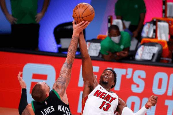 Bam Adebayo #13 of the Miami Heat and Daniel Theis #27 of the Boston Celtics compete for a jump ball during the fourth quarter in Game Two of the Eastern Conference Finals during the 2020 NBA Playoffs at AdventHealth Arena at the ESPN Wide World Of Sports Complex on September 17, 2020 in Lake Buena Vista, Florida