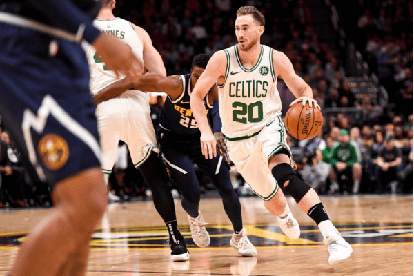 Gordon Hayward (20) of the Boston Celtics drives as Aron Baynes (46) sets a pick on Malik Beasley (25) of the Denver Nuggets during the first half on Monday, November 5, 2018. The Denver Nuggets hosted the Boston Celtics at the Pepsi Center