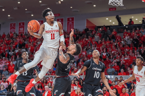 Houston Cougars guard Nate Hinton (11) towers over Cincinnati Bearcats guard Jarron Cumberland (34) as he attempts a second half finger roll during the basketball game between the Cincinnati Bearcats and Houston Cougars on February 10, 2019 at the Fertitta Center in Houston, Texas.