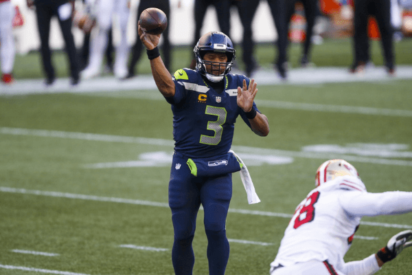 Nov 1, 2020; Seattle, Washington, USA; Seattle Seahawks quarterback Russell Wilson (3) passes against the San Francisco 49ers during the third quarter at CenturyLink Field.