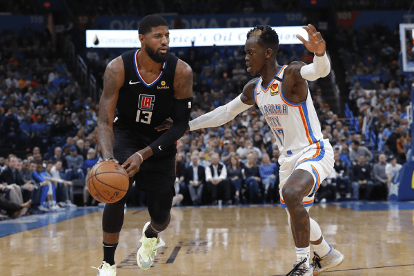 Mar 3, 2020; Oklahoma City, Oklahoma, USA; LA Clippers guard Paul George (13) drives to the basket against Oklahoma City Thunder guard Dennis Schroder (17) during the second quarter at Chesapeake Energy Arena.