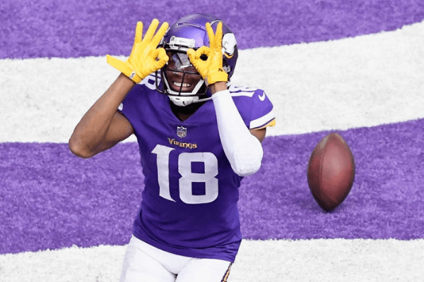 Justin Jefferson #18 of the Minnesota Vikings celebrates a touchdown against the Tennessee Titans during the third quarter of the game at U.S. Bank Stadium on September 27, 2020 in Minneapolis, Minnesota.