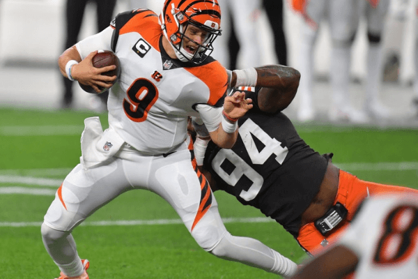 Joe Burrow #9 of the Cincinnati Bengals is sacked by Adrian Clayborn #94 of the Cleveland Browns during the first quarter at FirstEnergy Stadium on September 17, 2020 in Cleveland, Ohio.