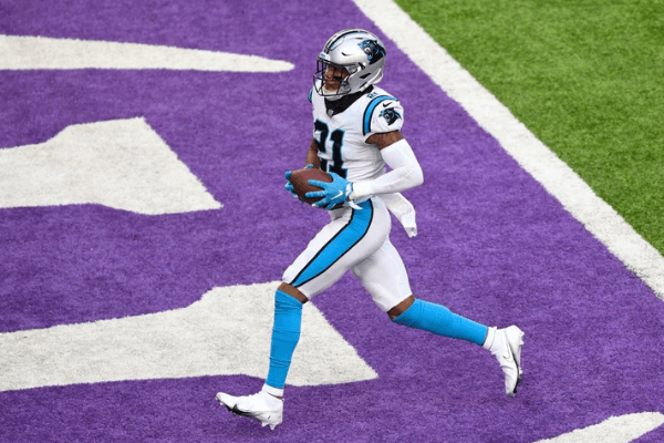 Jeremy Chinn #21 of the Carolina Panthers celebrates after recovering a fumble by Kirk Cousins #8 of the Minnesota Vikings (not pictured) and returning it for a touchdown during the third quarter at U.S. Bank Stadium on November 29, 2020 in Minneapolis, Minnesota.