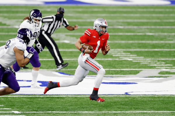 Justin Fields #1 of the Ohio State Buckeyes runs the ball in the first quarter against the Northwestern Wildcats during the Big Ten Championship at Lucas Oil Stadium on December 19, 2020 in Indianapolis, Indiana.
