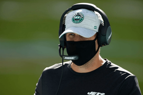 Head coach Adam Gase of the New York Jets looks on from the field during pre-game warm-up at Hard Rock Stadium on October 18, 2020 in Miami Gardens, Florida.