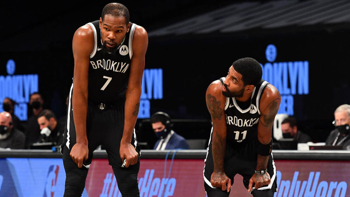 Kevin Durant and Kyrie Irving of the Brooklyn Nets look at each other