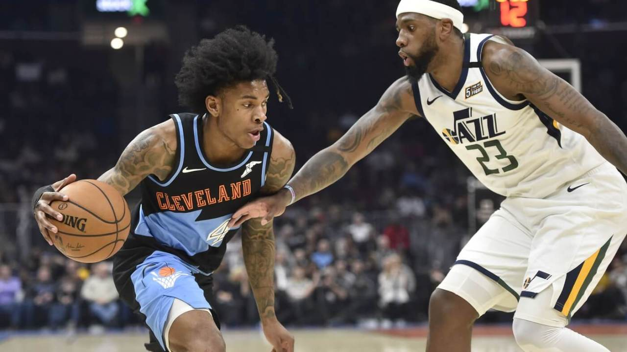 Cleveland Cavaliers guard Kevin Porter Jr. (4) drives against Utah Jazz forward Royce O'Neale (23) in the second quarter at Rocket Mortgage FieldHouse.