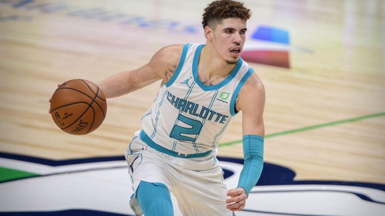 Charlotte Hornets guard LaMelo Ball (2) brings the ball up court against the Dallas Mavericks during the second half at the American Airlines Center.