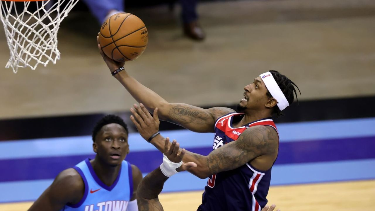 Washington Wizards guard Bradley Beal (3) drives to the net against the Houston Rockets during the second quarter at Toyota Center.