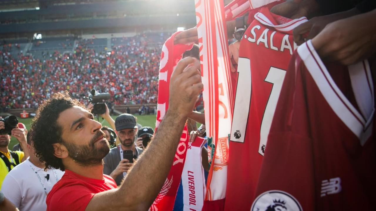Jul 28, 2018; Ann Arbor, MI, USA; Liverpool player Mohamed Salah signs jerseys after an International Champions Cup soccer match against Manchester United at Michigan Stadium. Mandatory Credit: Cameron Pollack/Detroit Free Press via USA TODAY Sports